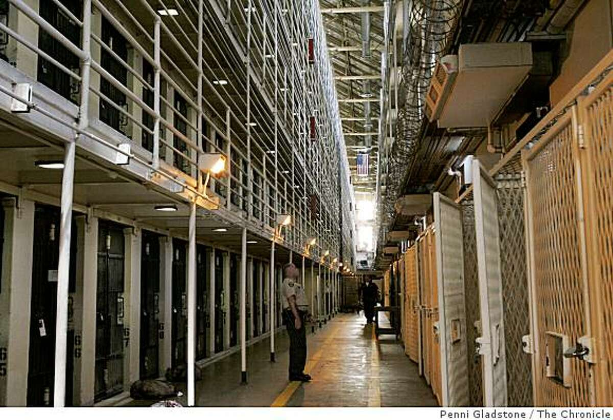 Guards patrol the East Block of San Quentin's Death Row.