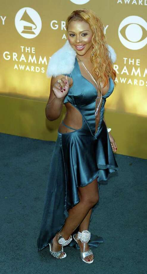 Lil Kim's 2004 ensemble was hideous, but at least there were no pasties in sight. Photo: Kevin Winter, Getty Images / 2004 Getty Images