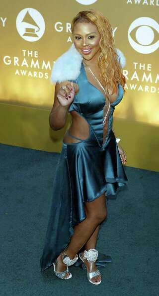 Lil Kim's 2004 ensemble was hideous, but at least there were no pasties in sight.