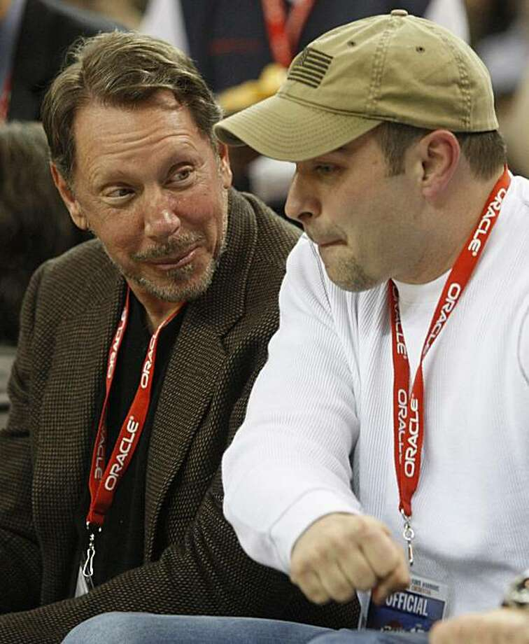 Oracle Corp. CEO Larry Ellison, left, watches the Cleveland Cavaliers and the Golden State Warriors on Monday in Oakland. Photo: Ben Margot, AP