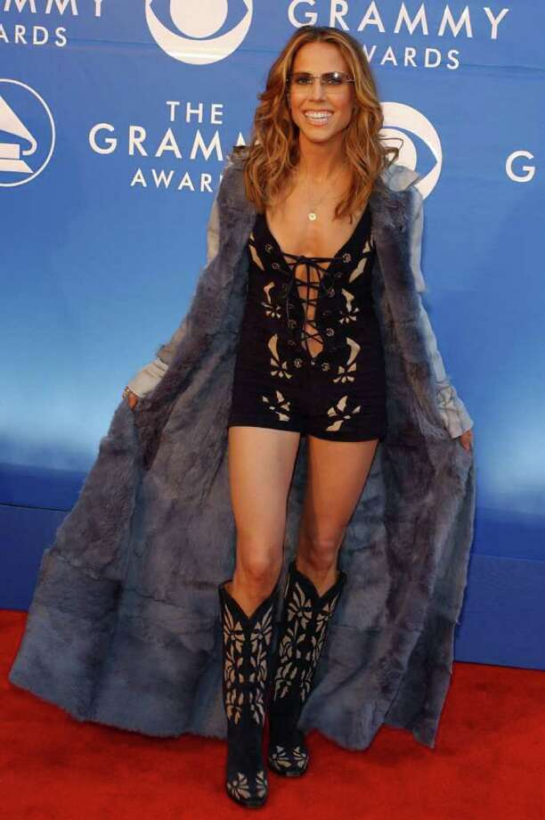 It's a bird, it's a plane, it's Sheryl Crow in 2002.  Photo: LUCY NICHOLSON, AFP/Getty Images / AFP