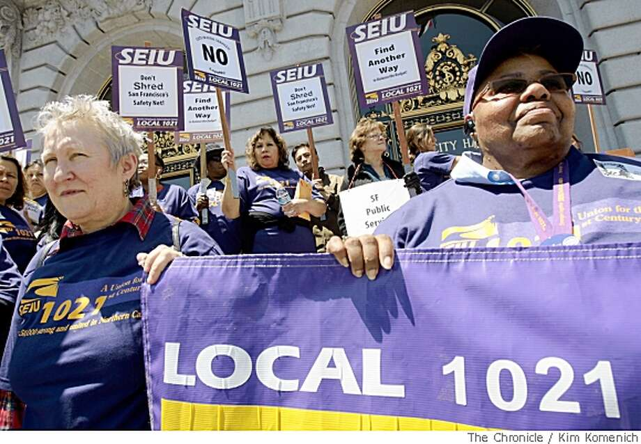 Union supporters Sally Buchmann, left, and Linda Martin of San Francisco General Hospital hold a banner as members of Service Employees International Union Local 1021 hold a rally on the steps of San Francisco City Hall on Thursday, May 22, 2008.Photo by Kim Komenich / San Francisco Chronicle Photo: Kim Komenich, SFC