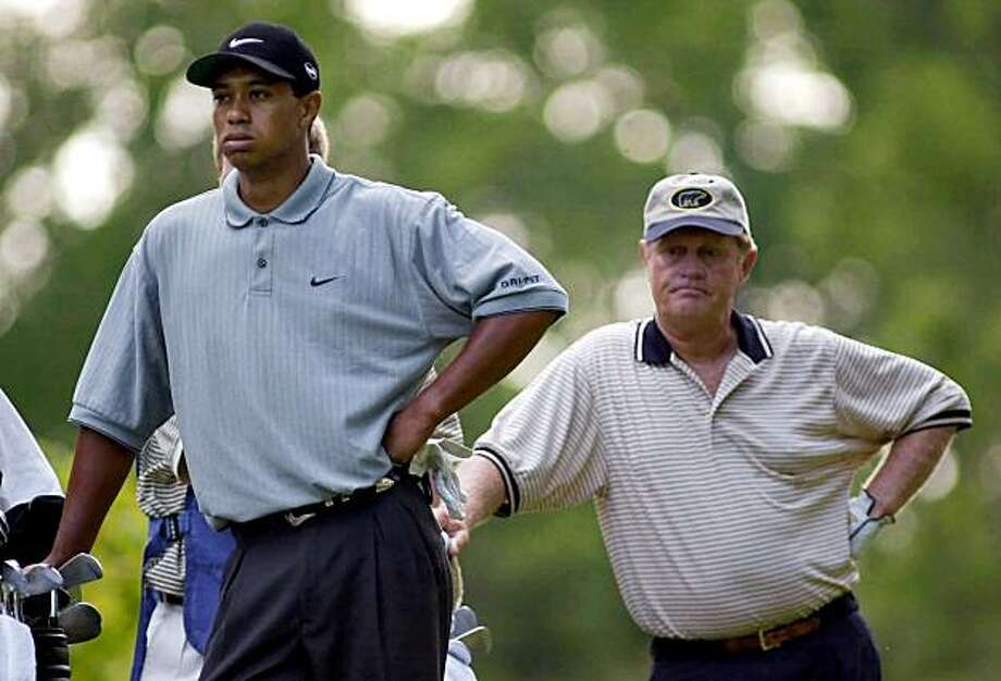 FILE - In this Aug. 17, 2000 file photo, Tiger Woods and Jack Nicklaus strike a pose as they wait to tee off on the second hole during the first round of the PGA Championship at the Valhalla Golf Club in Louisville, Ky. Nicklaus believes this is a big year for Woods to get closer to his record 18 major championships because three majors are held on courses where Woods has won. Woods has taken an indefinite leave while he copes with a personal crisis involving extramarital affairs. No one knows when he will return, even with a major rotation that features Augusta National, Pebble Beach and St. Andrews. Photo: Dave Martin, AP