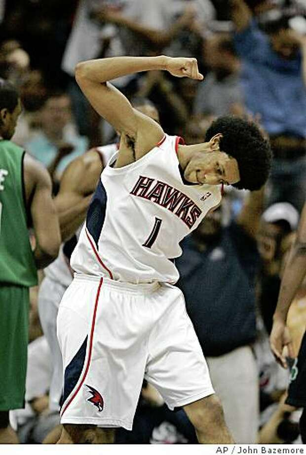 Atlanta Hawks guard Josh Childress (1) reacts after scoring in the fourth quarter in Game 6 of a first-round NBA playoff basketball series against the Boston Celtics, Friday, May 2, 2008 in Atlanta. Atlanta won 103-100 to even the best-of-seven games series at 3-3. Game 7 is scheduled for Sunday, May 4 in Boston. Photo: John Bazemore, AP