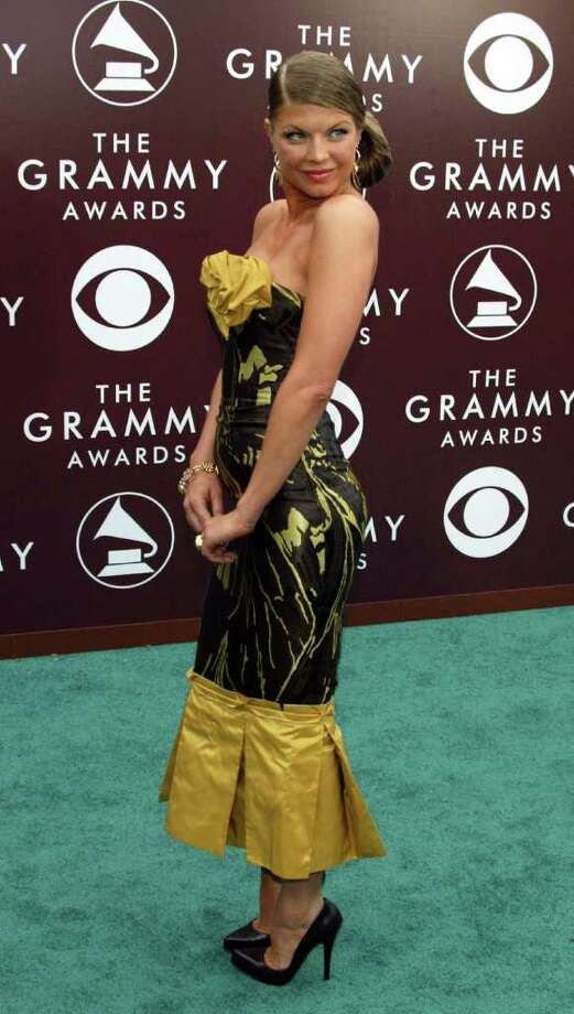 This frumpy 2005 gown was a far cry from Fergie's usual futuristic fashions.  Photo: Kevin Winter, Getty Images / 2005 Getty Images