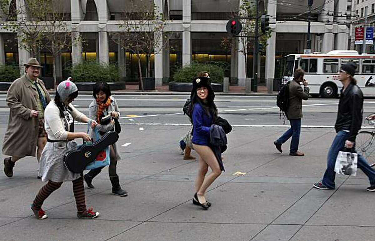 One of the participants in the No Pants! Subway Ride 2010 walks without pants along Market Street on Sunday after leaving the Embarcadero BART station.