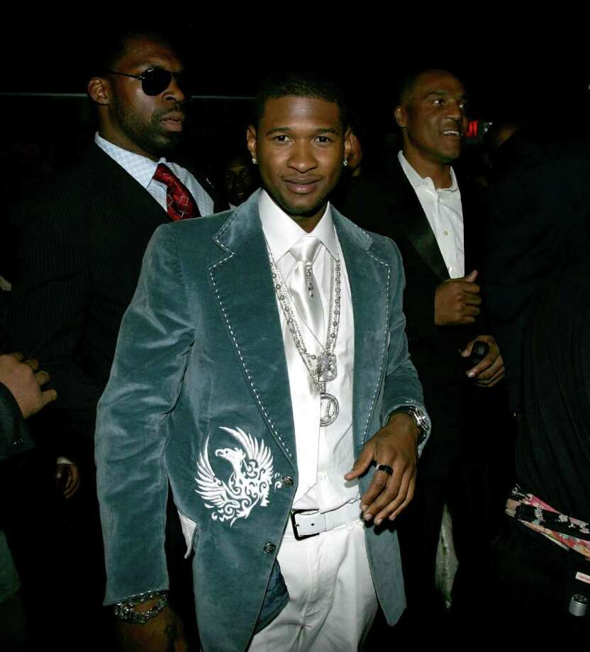 What was Usher thinking in 2005 with this teal velour jacket and serpentine neckware? Photo: Frank Micelotta, Getty Images / 2005 Getty Images