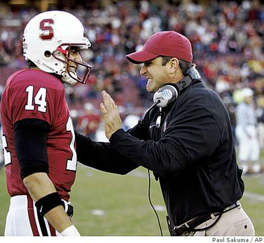 Stanford coach Jim Harbaugh, right, talks with quarterback Tavita Pritchard during the first quarter of a football game against California in Stanford, Calif., Saturday, Dec. 1, 2007. (AP Photo/Paul Sakuma) Photo: Paul Sakuma, AP