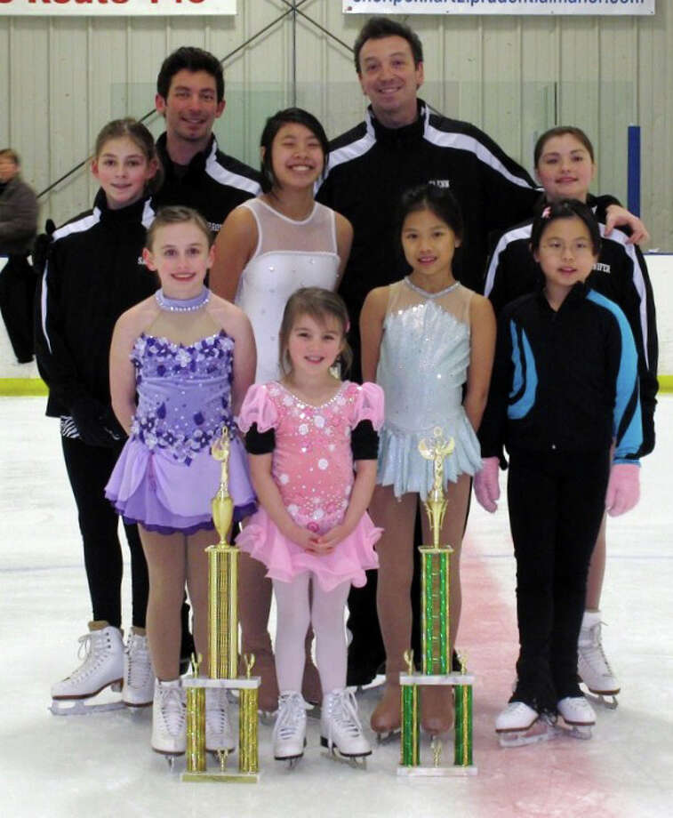 Ziehnert Skating School members include, front row, from left: Ashlyn Chartier, 8, of Waterford; Jullianna Bonn, 5, Waterford;  Katie Dunleavy, 9, of Troy, and Joyce Chen, 8, Clifton Park. Second row: Sara Parker, 12, of Saratoga; Molly Gagnon, 12, of Saratoga,; and  Jennifer Steele, 11, of Saratoga,. Coaches are Justin Morrow and Glenn Ziehnert.