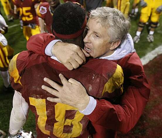 FILE - In this Dec. 26, 2009 file photo, Southern California head coach Pete Carroll celebrates with wide receiver Damian Williams, the game's most valuable player, after a win over Boston College in the Emerald Bowl NCAA college football game in San Francisco. Carroll has reportedly agreed to leave Southern California after nine years to return to the NFL and coach the Seattle Seahawks. ESPN cited multiple league sources Saturday, Jan. 9, 2010, saying Carroll reached an agreement with a team that went 5-11 and fired coach Jim Mora on Friday after one season. The Los Angeles Times reported Carroll also will be team president. Photo: Marcio Jose Sanchez, AP