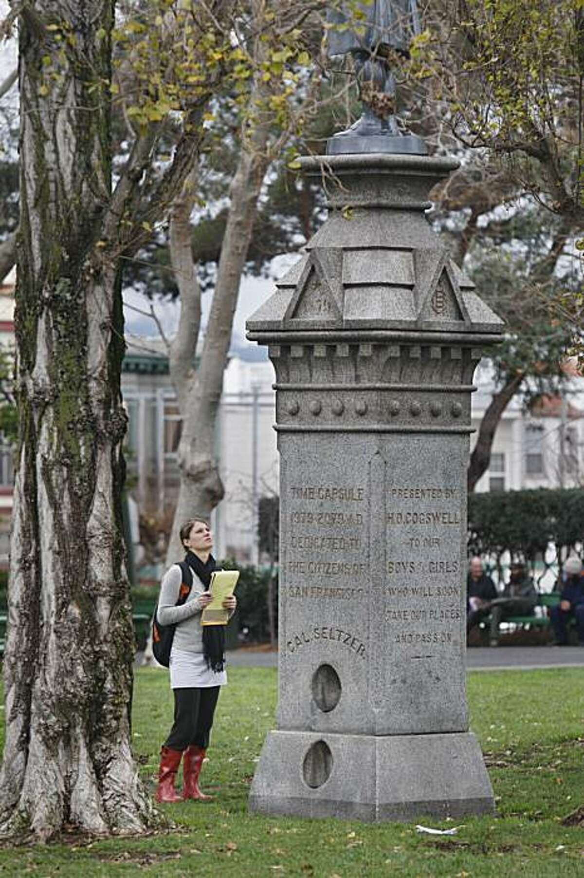 Barbara Nazarewicz, UC Davis landscape architecture student, studies a statue at Washington Square while taking a tour of the park in San Francisco, Calif. on Tuesday, January 12, 2010.