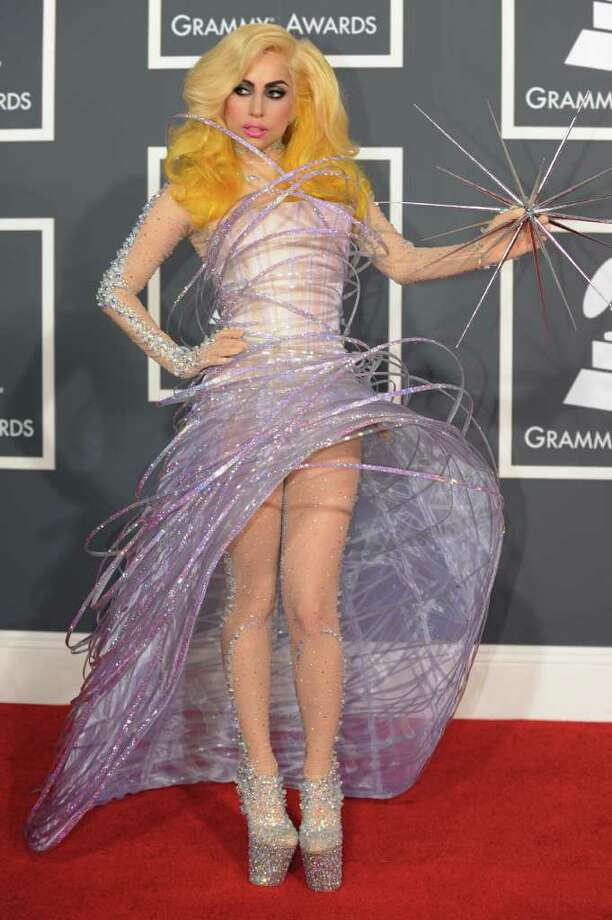 Say what you will about Lady Gaga, but she never bores on the red carpet. Here she is in 2010 with yellow hair, a futuristic dress, and a spikey star.  Photo: GABRIEL BOUYS, AFP/Getty Images / 2010 AFP