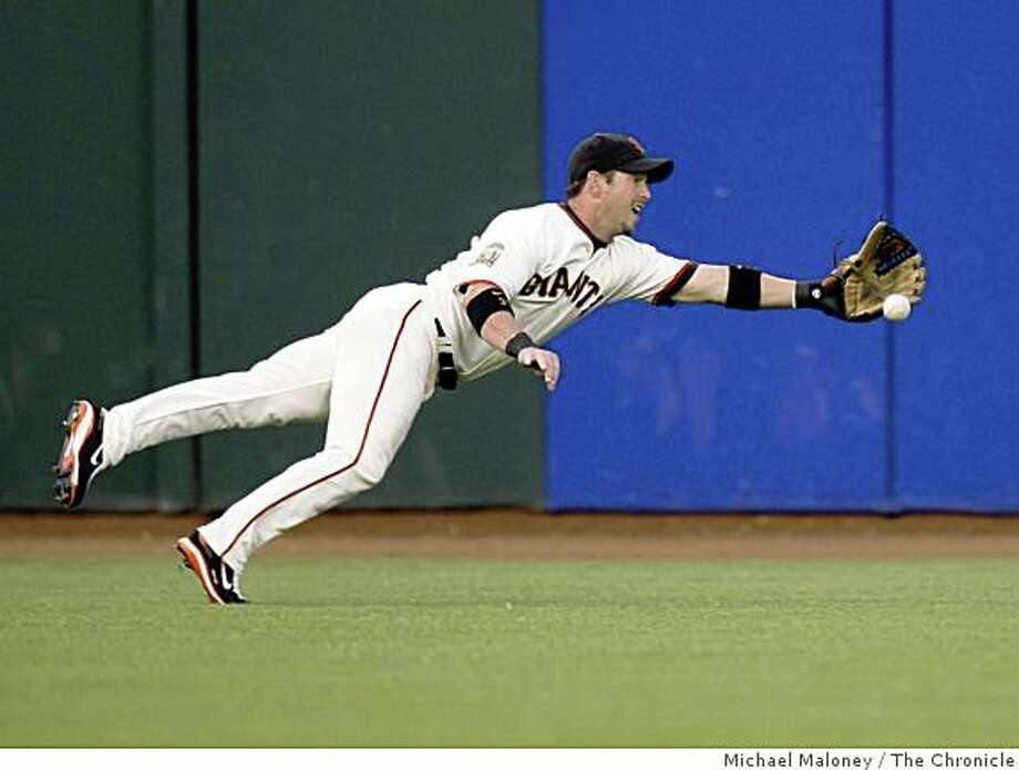 San Francisco Giants Aaron Rowand misses a ball hit by Washington Nationals Jesus Flores in the 2nd inning. Chronicle photo by Michael Maloney Photo: Michael Maloney, The Chronicle
