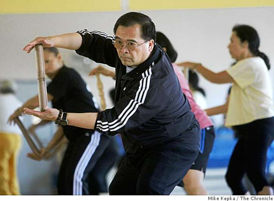Bryant Fong, of San Francisco, teaches a Taiji class at the Buchanan YMCA on Thursday July 24, 2008 in San Francisco, Calif. Fong says he thinks politics and sports shouldn't mixed and the Olympics should be strictly meant for the Athletes who have work to get to the top of their game. Photo by Mike Kepka / The Chronicle Photo: Mike Kepka, The Chronicle