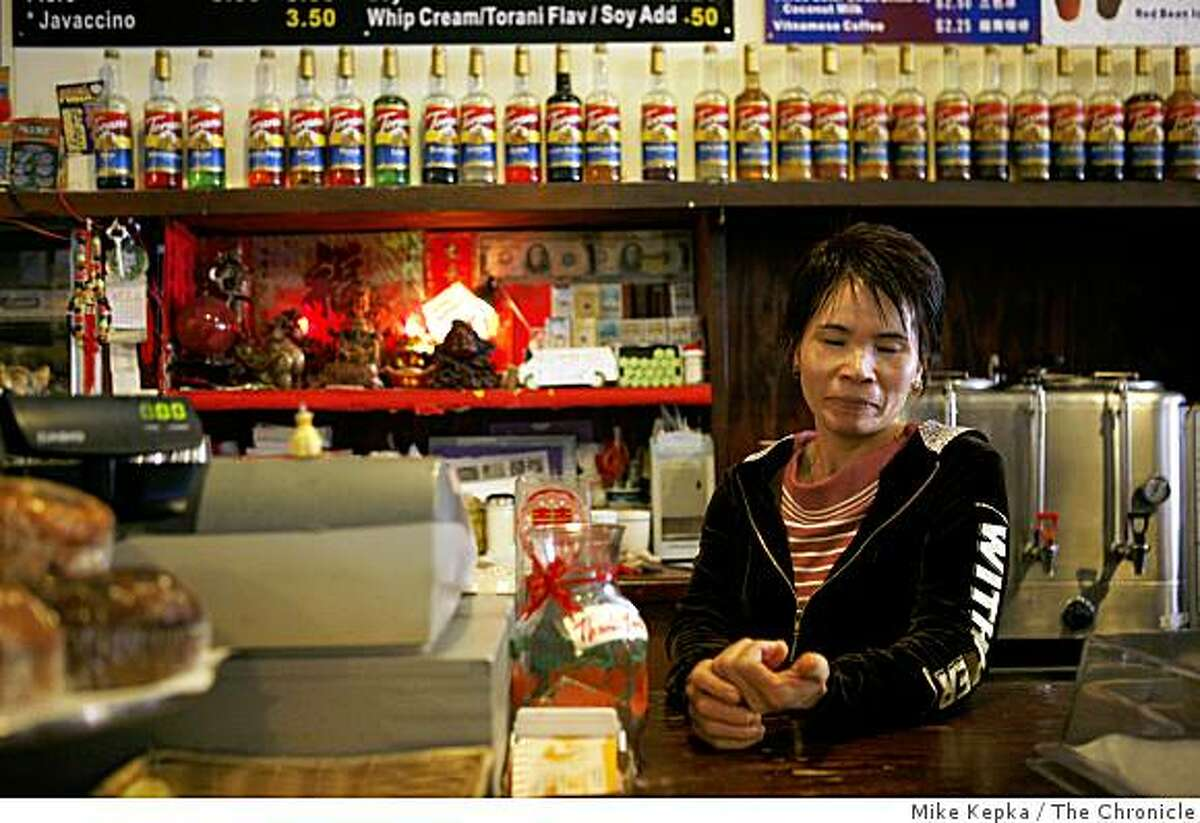 Chu Mei Yang, of San Francisco, poses for a portrait in her Clement Street coffee shop called Java Source on July 24, 2008 in San Francisco, Calif. Yang, who works nearly 12 hours a 7 days a week, says she is so busy with work she doesn't think she even be able to watch any of the Olympics. Photo by Mike Kepka / The Chronicle