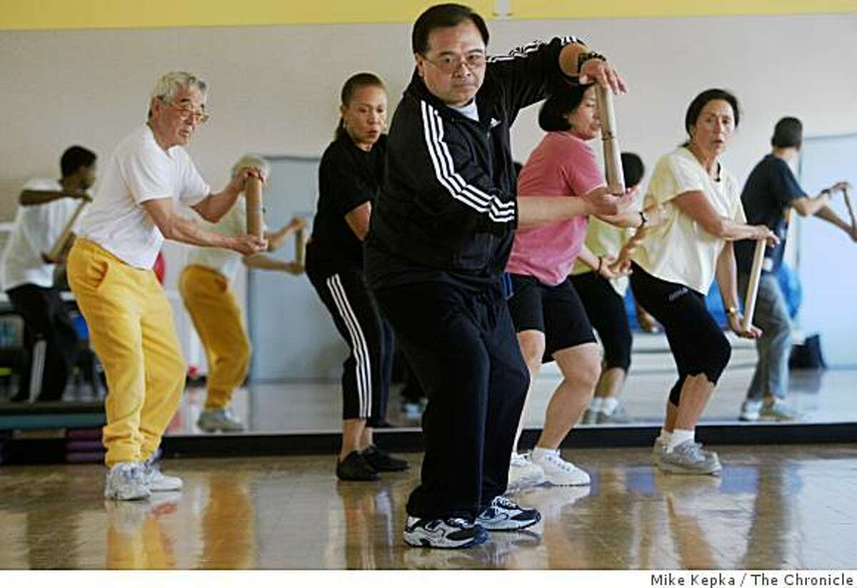 Bryant Fong of San Francisco teaches a Taiji class at the Buchanan YMCA on Thursday July 24, 2008 in San Francisco, Calif. Fong says he thinks politics and sports shouldn't mix and the Olympics should be strictly meant for the Athletes who have work to get to the top of their game. Photo by Mike Kepka / The Chronicle