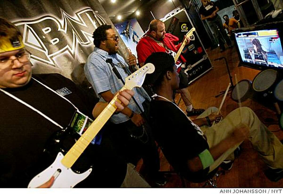 Video game publisher Electronic Arts Inc. posted a smaller net loss for its fiscal first quarter Tuesday and more than doubled its revenue thanks to soaring sales of games such as ?Rock Band? ? even as it spent more on marketing and development.