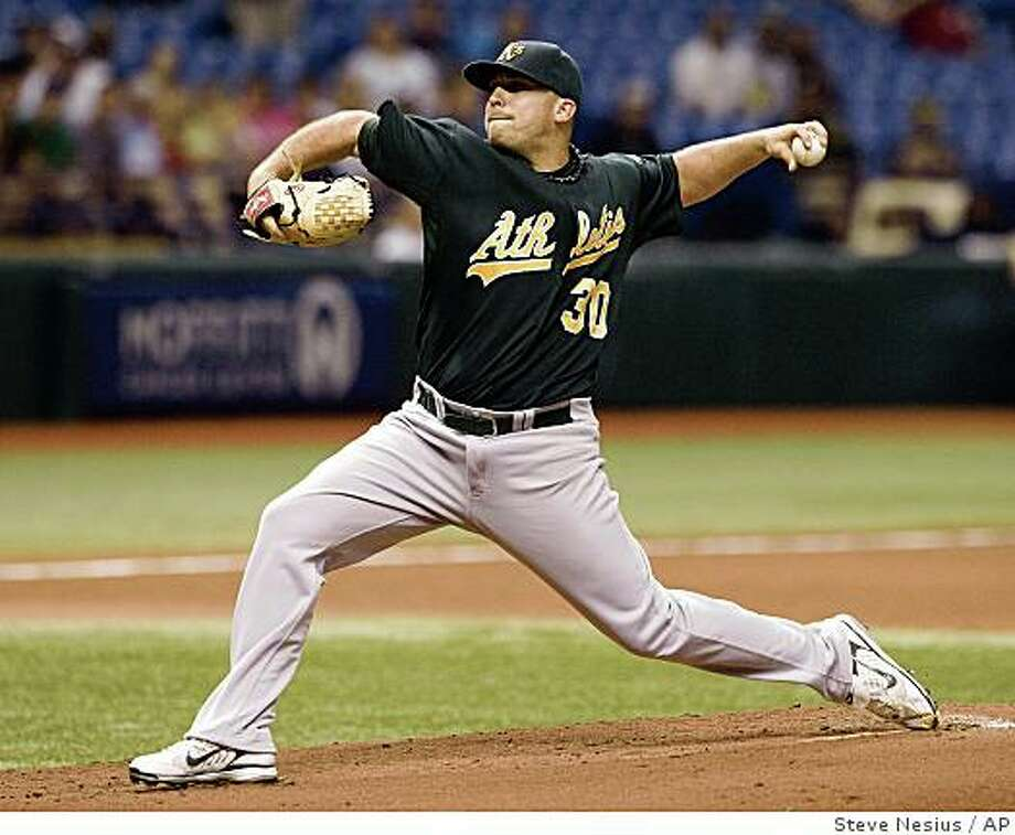 Oakland Athletics starter Dana Eveland pitches against the Tampa Bay Rays during the first inning of a baseball game Monday, July 21, 2008 in St. Petersburg, Fla. (AP Photo/Steve Nesius) Photo: Steve Nesius, AP