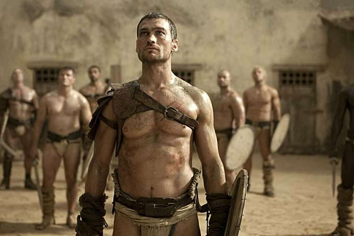 In this TV publicity image released by Starz, Andy Whitfield portrays Spartacus in the Starz original series,