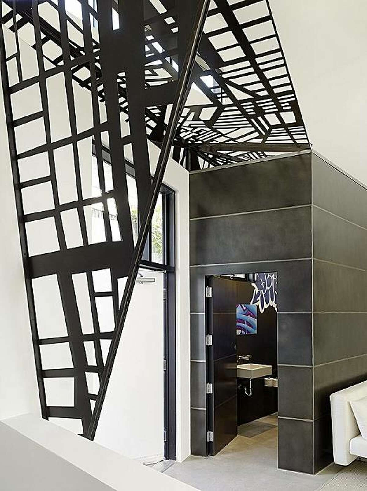 This loft in Venice, Calif., needed a better sense of entry, so Hutton created a canopy of steel cut into the pattern of the streets in the neighborhood.