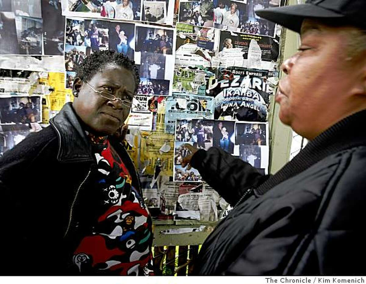 Shelly Wells, left, listens to Kim Humphrey-Jones as they discuss the photos posted on a bulletiin board at the park on Fillmore Street between Golden Gate and Turk in San Francsico, Calif., on Tuesday, July 15, 2008. San Francisco's Redevelopment Agency is set to leave the Western Addition in January, ending a 40-year �urban renewal�project that was touted as a move to wipe out blight. In the process the project dispersed San Francisco�s largest thriving black community.Photo by Kim Komenich / The Chronicle