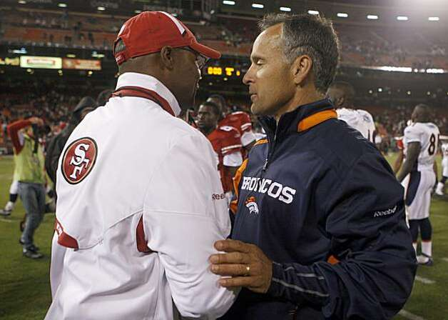 Mike Singletary and Mike Nolan meet on the field after the San Francisco 49ers vs. Denver Broncos pre-season football game at Candlestick Park in San Francisco, Calif., on Friday, Aug. 14, 2009. Photo: Paul Chinn, The Chronicle