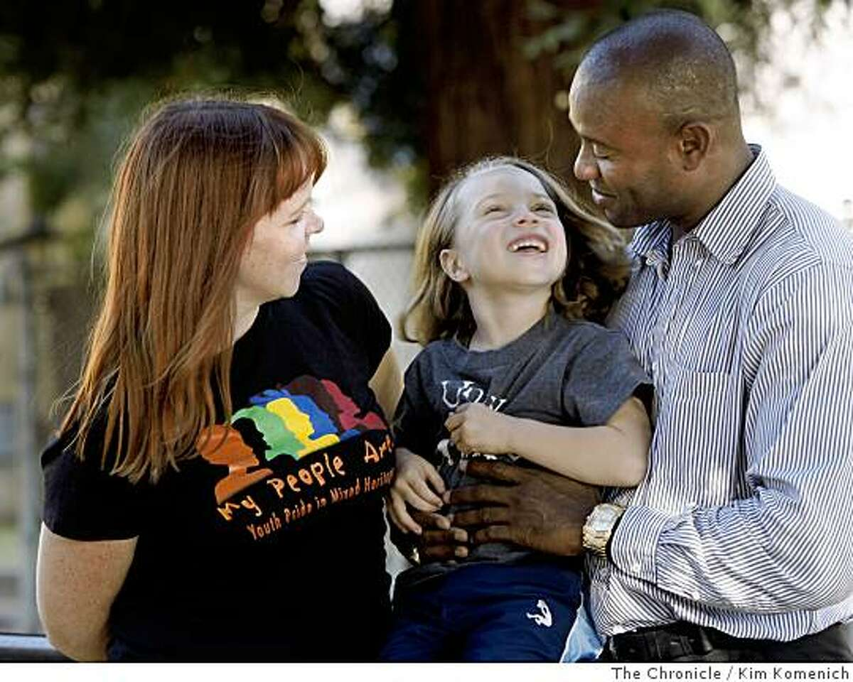 Tarah Fleming, Randolph Brooks and their son Loyal, 4, play together at a Berkeley, Calif., park on Wednesday, July 16, 2008. Fleming is director of iPride, a multiracial education group, based in Berkeley, Photo by Kim Komenich / The Chronicle
