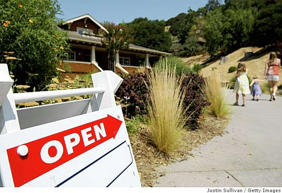 FAIRFAX, CA - JULY 24: A sign advertising an open house is posted outside a home for sale July 24, 2008 in Fairfax, California. According to a report by The National Association of Realtors, sales of existing homes slumped 2.6 percent for the month of June, 15.5 percent lower than last year. (Photo by Justin Sullivan/Getty Images)