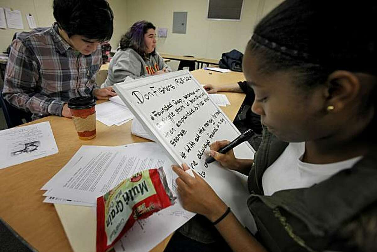 Senior Kosa Sanders (right) uses a white board to prepare a presentation in class on Don Fisher. San Francisco's Excelsior district charter high school, Center for Arts and Technology, is considered a real success story in the controversy about charter vs. regular schools in San Francisco.