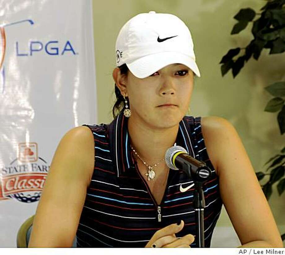 In this photo provided by the State Farm Classic golf tournament, Michelle Wie speaks to reporters just after learning she had been disqualified from the LPGA State Farm Golf Classic Saturday, July 19, 2008, in Springfield, Ill. (AP Photo/State Farm Classic, Lee Milner) ** NO SALES ** Photo: Lee Milner, AP