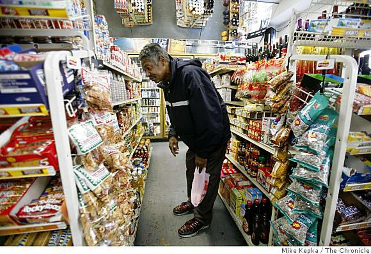 At his neighborhood convenience store, California Grocery, Tenderloin resident, WIlliam Briggs searches through shelf full of cans for his favorite brand of pork and beans. Wednesday July 23, 2008 in San Francisco, Calif. He later moved on after he decided they didn't have what he was looking for. Photo by Mike Kepka / The Chronicle