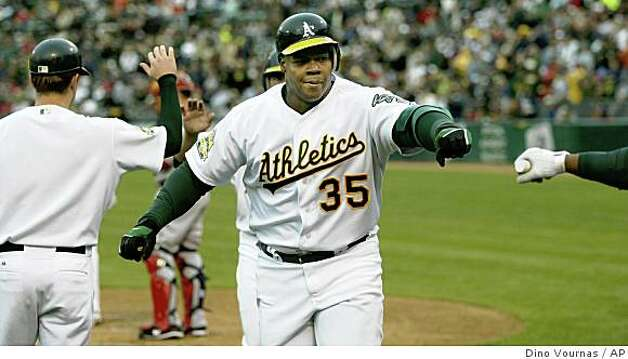 Oakland Athletics Frank Thomas comes in after hitting a 2-run home run against the Boston Red Sox' Tim Wakefield  in the first inning of an MLB baseball game, Friday, May 23, 2008 in Oakland, Calif. Photo: Dino Vournas, AP