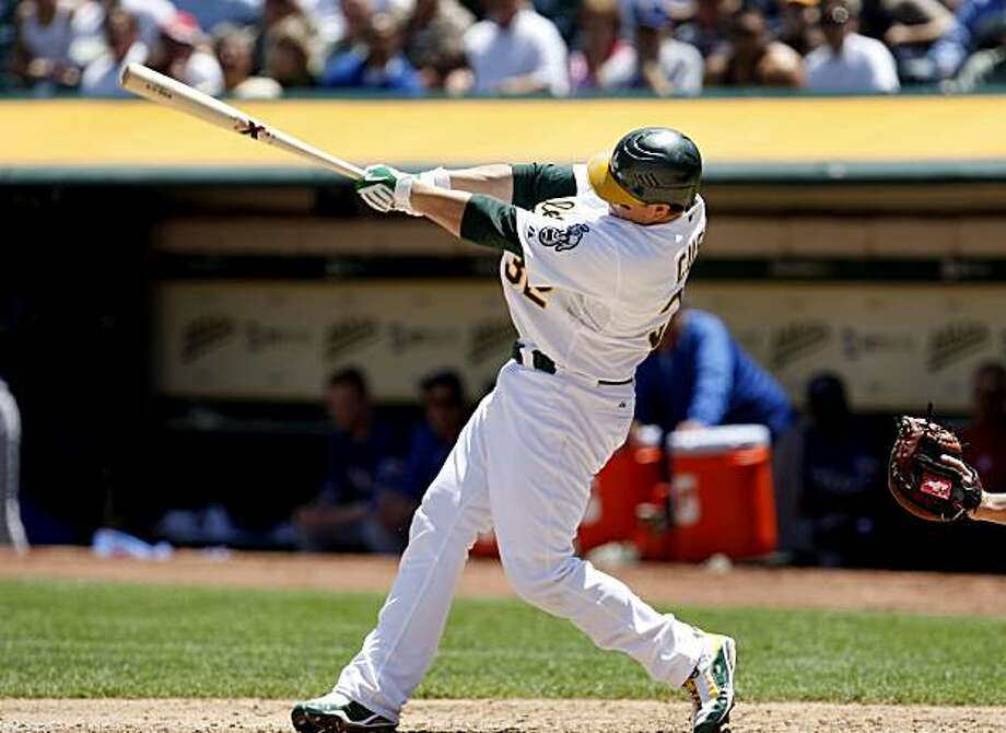 Jack Cust hits a grand slam in the fourth inning to give the A's a 4-0 lead. Photo: Brant Ward, The Chronicle