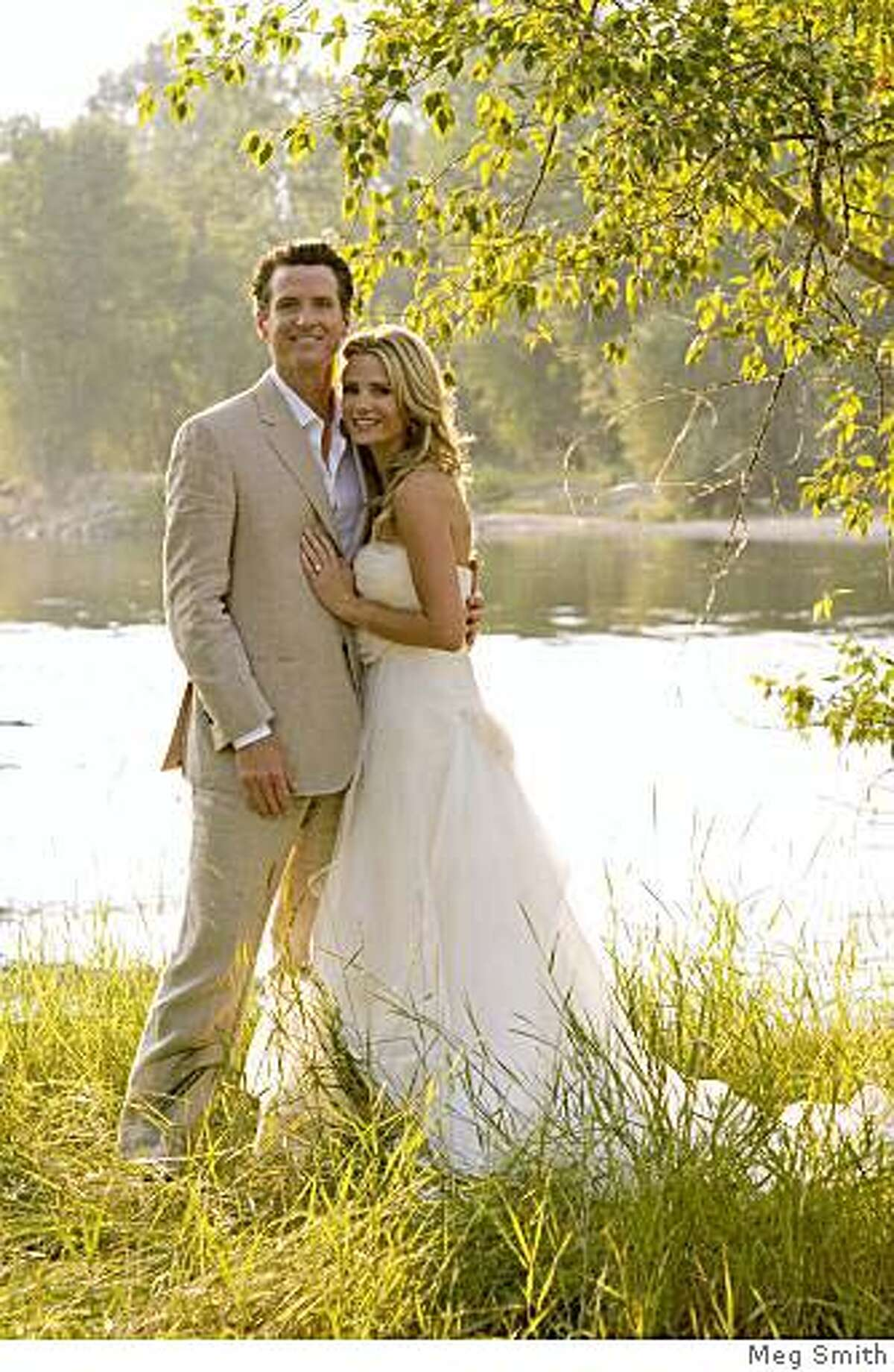 """San Francisco Mayor Gavin Newsom poses with his new wife actress Jennifer Siebel July 26, 2008 in Stevensville, Montana. Newsom and Siebel were married at her parents' Montana ranch. The actress has a recurring role on the TV series """"Life."""" (Meg Smith via Getty Images)"""