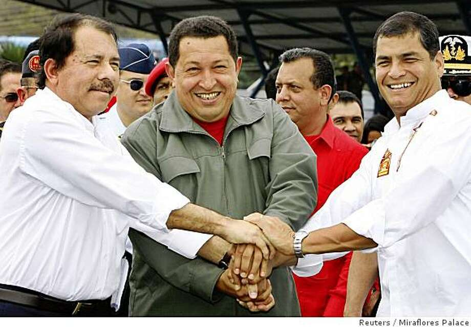 Venezuela's President Hugo Chavez (C) join hands with Nicaragua's President Daniel Ortega (L) and Ecuador's President Rafael Correa during a ceremony at Eloy Alfaro airport in Manta July 15, 2008. REUTERS/Mirafllores Palace/Handout (ECUADOR) Photo: Miraflores Palace, Reuters