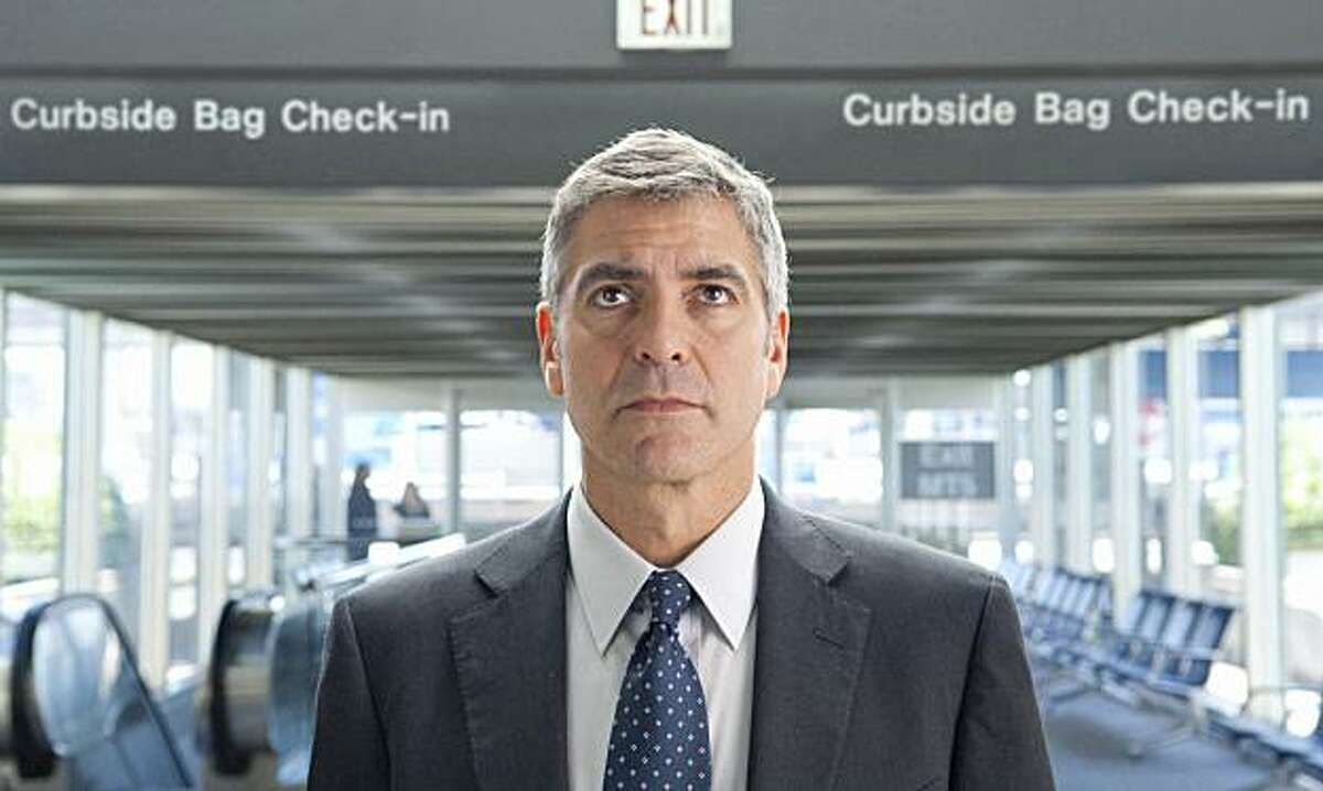 In this film publicity image released by Paramount, George Clooney portrays Ryan Bingham in a scene from
