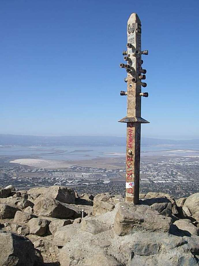South Bay salt flats can be seen beyond the summit spike atop 2,517-foot Mission Peak, which is adorned with sighting pipes that line up with surrounding landmarks. Photo: Paul McHugh