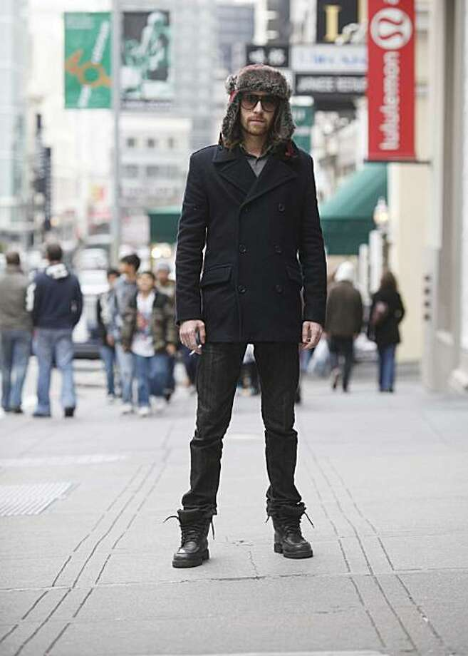 Standing on Grant Street near Union Square, James Norton, 27, of San Diego, shows off his faux fur trapper hat and Target jacket with Levi's jeans and boots. Photo: Mike Kepka, The Chronicle