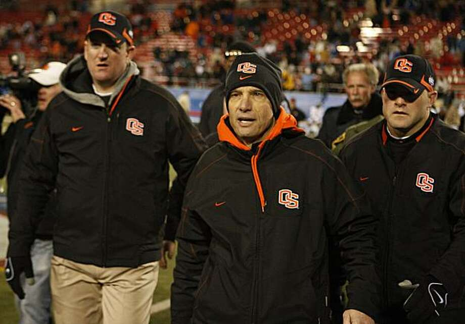 Oregon State head coach Mike Riley, center, leaves the field following the Las Vegas Bowl NCAA college football game in Las Vegas, Tuesday Dec. 22, 2009.Oregon lost to BYU 44-20. (AP Photo/Daniel Gluskoter) Photo: Daniel Gluskoter, AP
