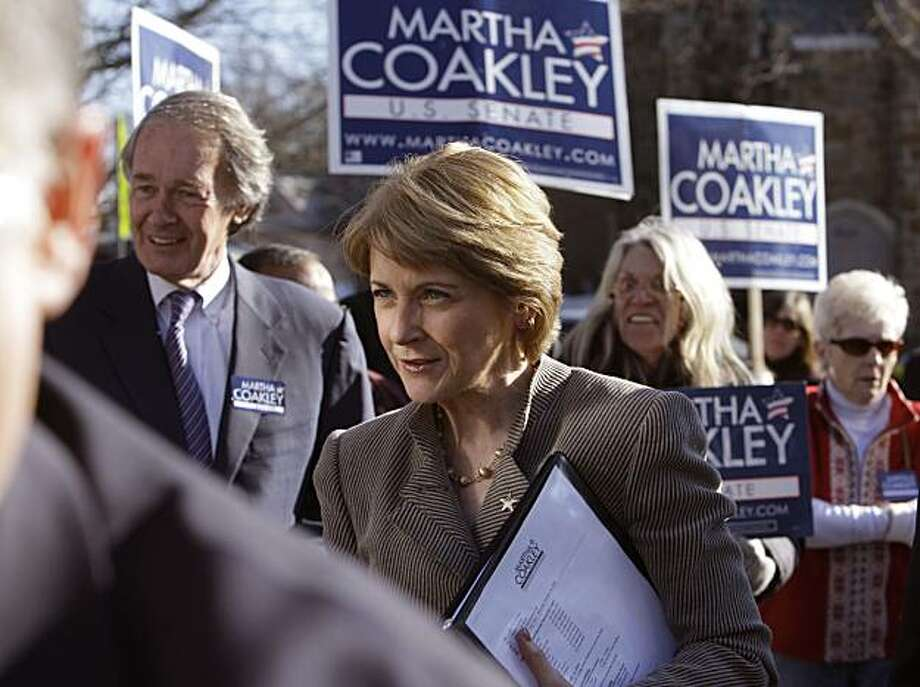 Mass. Attorney General Martha Coakley, the Democratic candidate vying for the seat vacated by the death of U.S. Sen. Edward Kennedy, D-Mass., talks with supporters while walking with U.S. Rep. Ed Markey, D-Mass., left, during a campaign stop in Melrose, Mass., Saturday, Jan. 16, 2010.  Coakley and Republican candidate Scott Brown are campaigning across the state in the final weekend push before the special election on Tuesday Jan. 19th. Photo: Charles Krupa, AP