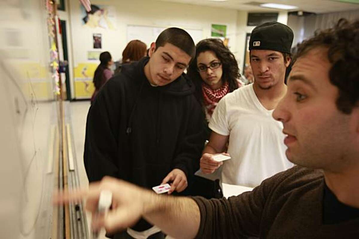 Berkeley High sophomore Matthew Abangan (second from right), 16, discusses the lab assignment with teacher Uri Skowronski (right) along with students Jordi Buendia (left), 16 and Razan Qatami (second from left), 15, in Berkeley, Calif. on Monday January 4, 2009.