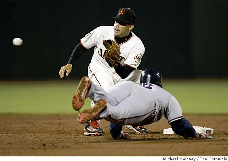 San Francisco Giants Omar Vizquel gets the throw in time to tag out Washington Nationals Felipe Lopez on an attempted steal in the 6th inning. Photo by Michael Maloney / The Chronicle Photo: Michael Maloney, The Chronicle