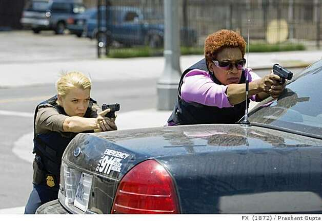The Shield: Episode 1: Laurie Holden as Agent Olivia Murray (L) and CCH Pounder as Claudette Wyms. CR: Prashant Gupta / FX The Shield: Episode 1: Laurie Holden as Agent Olivia Murray (L) and CCH Pounder as Claudette Wyms. CR: Prashant Gupta / FX Photo: Prashant Gupta, FX 1872