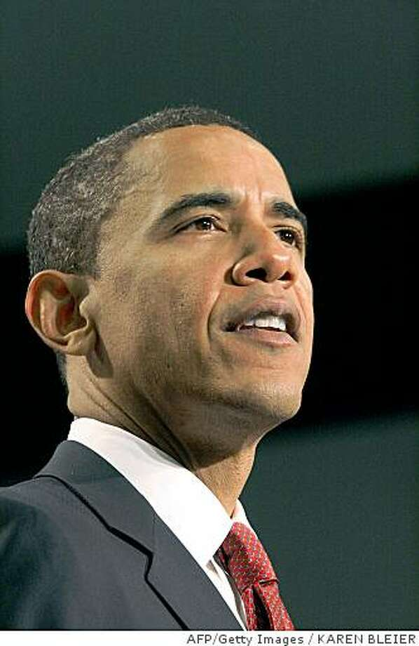 "Presumptive Democratic presidential candidate Illinois Sen. Barack Obama delivers remarks July 15, 2008 at the Ronald Reagan Building in Washington, DC. White House hopeful Barack Obama Tuesday promised to shift the ""single-minded"" US focus on Iraq to a threatening ""terrorist sanctuary"" in tribal Pakistan, in a broad new blueprint for US foreign policy.Setting the stage for a major foreign tour designed to bolster his commander-in-chief credentials, Obama called for tough, principled US diplomacy, rooted in his vow to get most US troops home from Iraq in 16 months. AFP PHOTO/Karen BLEIER (Photo credit should read KAREN BLEIER/AFP/Getty Images) Photo: KAREN BLEIER, AFP/Getty Images"