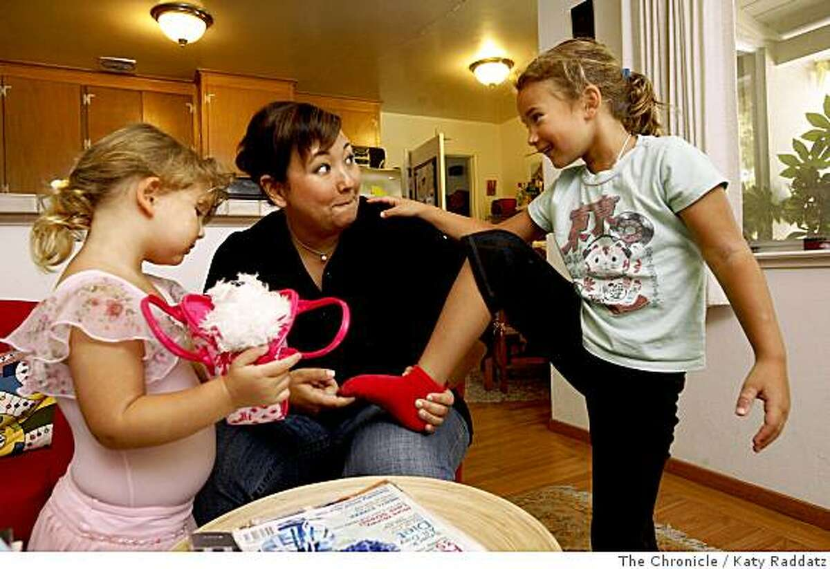 Stefania Pomponi Butler, center, who just spent three days at the BlogHer Conference, a very successful blogger writing about housewifely topics, politics, and culture on blogs MOMocrats and Kimchi Mamas, says the best thing about being able to work from her home is spending time with her daughters Bunny, age 6, right, who has a