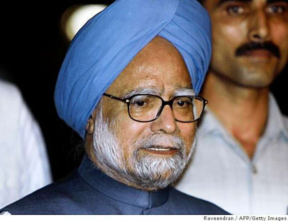 Indian Prime Minister Manmohan Singh talks to media representatives after the vote of confidence at Parliament house in New Delhi on July 22, 2008.  India's embattled coalition government survived a chaotic parliamentary confidence vote, clearing the way for it to forge ahead with a civilian nuclear energy deal with the United States.  AFP PHOTO/RAVEENDRAN (Photo credit should read RAVEENDRAN/AFP/Getty Images) Photo: Raveendran, AFP/Getty Images