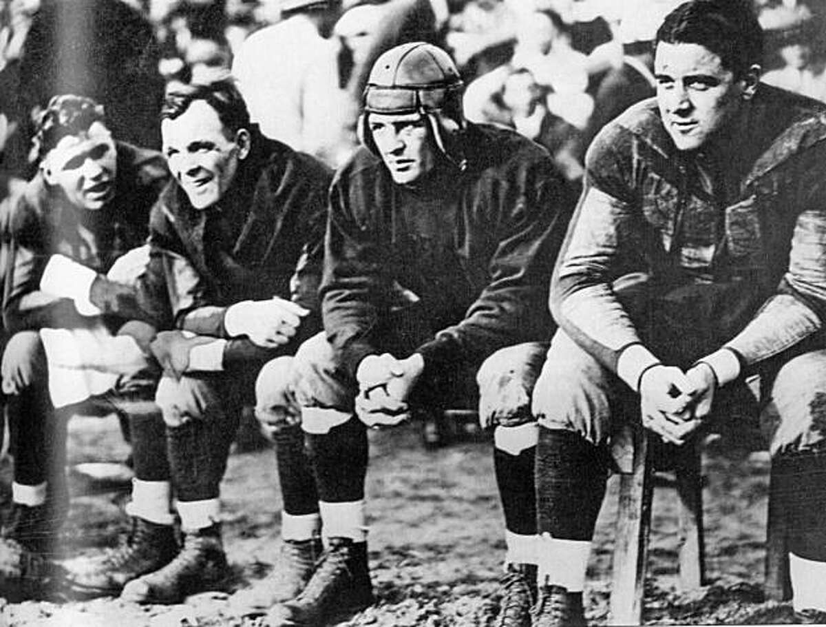 """Red Grange, by contract, had to sit out two quarters of every game during the barnstorming tour to save his health. George Halas (left of george) was always close by. from the book """"the first star"""" by lars anderson"""
