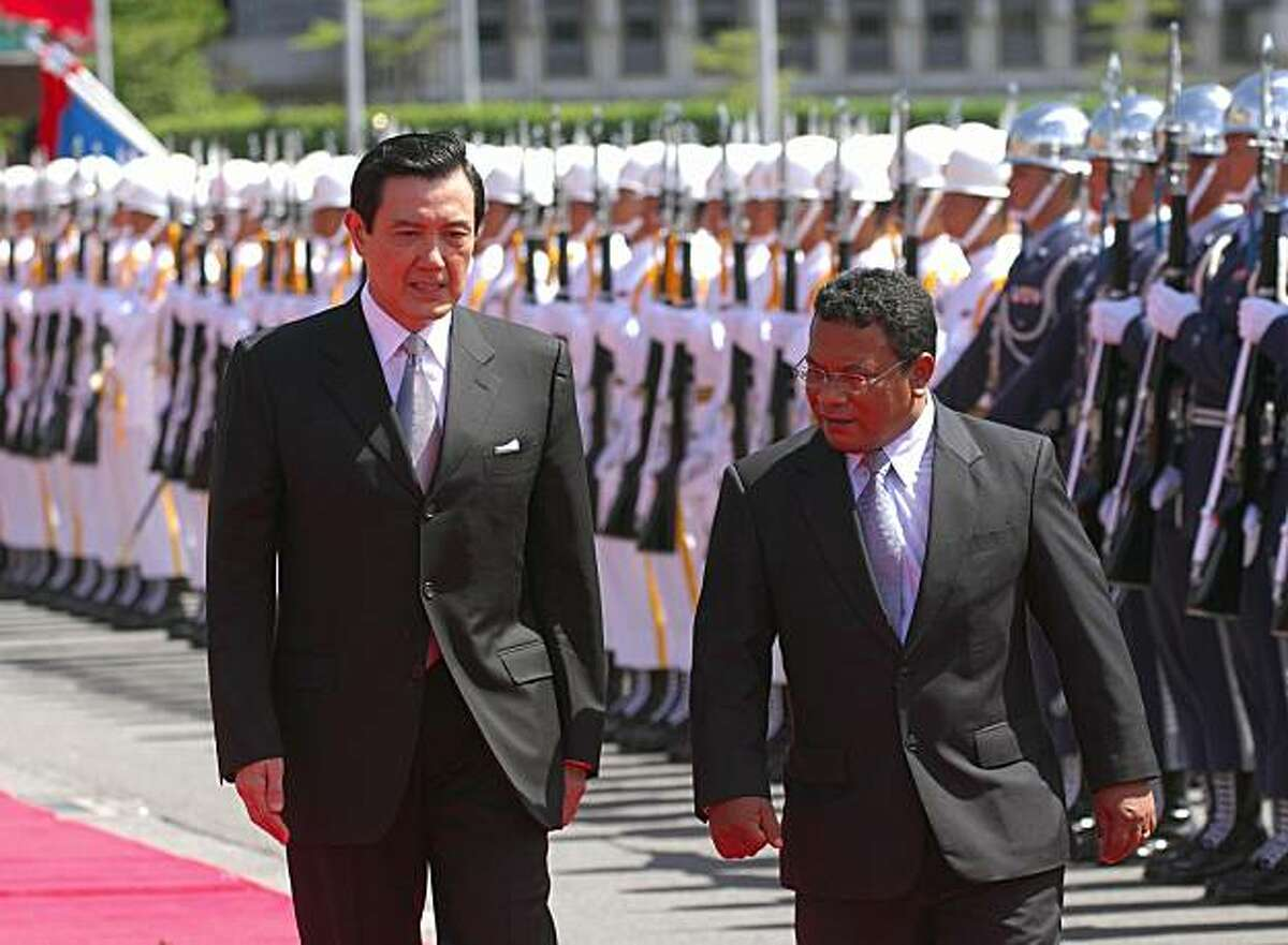 Taiwan President Ma Ying-jeou (L) and visiting Nauru President Marcus Stephen jointly review Taiwanese military honour guards as the island rolled out red carpet to welcome Stephen in Taipei on August 5, 2008. Ma pledged to share his country's development experience with Nauru, which is one of the 23 countries to recognise Taipei. AFP PHOTO/Sam YEH (Photo credit should read SAM YEH/AFP/Getty Images)