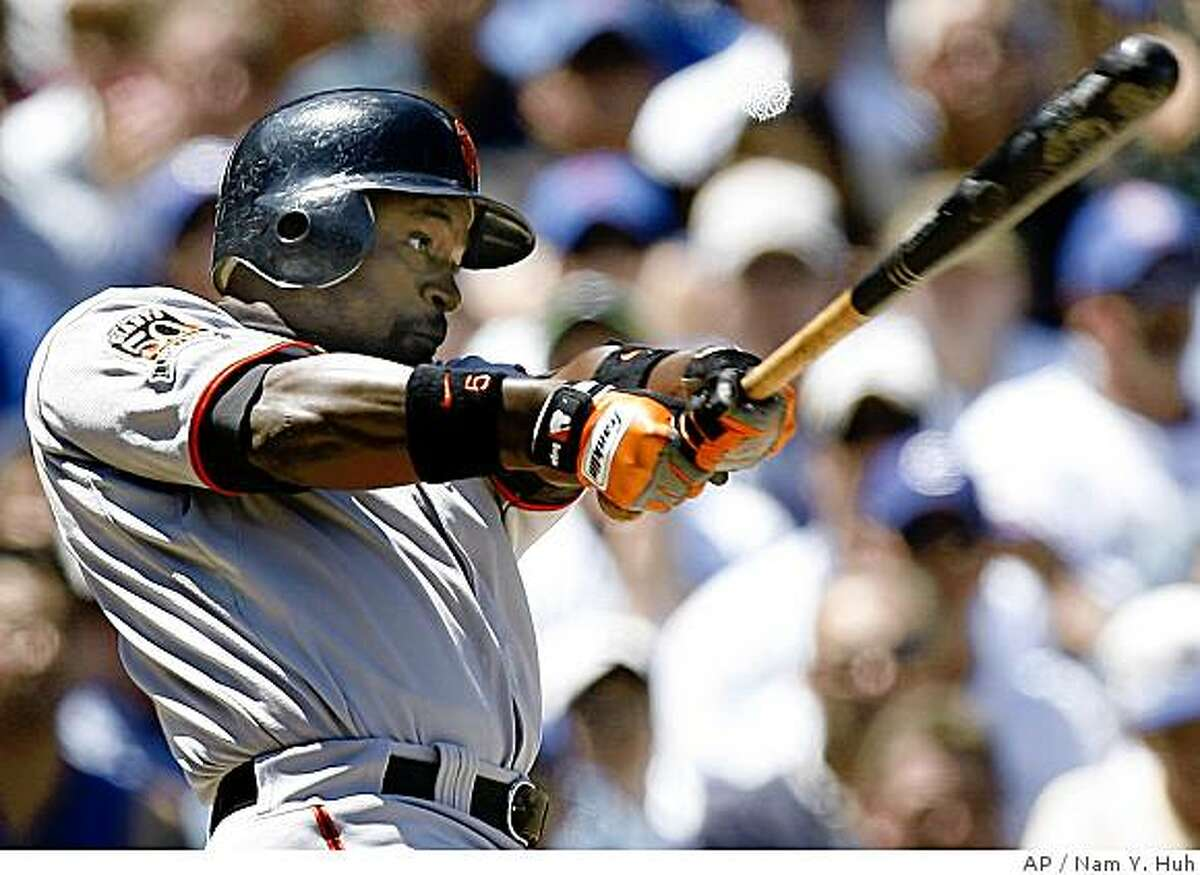 San Francisco Giants' Ray Durham hits a two-run RBI single against the Chicago Cubs during the third inning of a baseball game Sunday,July 13, 2008, in Chicago.(AP Photo/Nam Y. Huh)