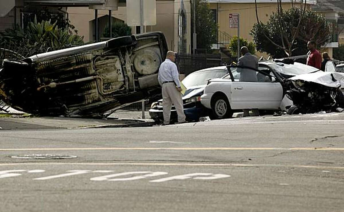 Police chased a vehicle traveling at a high rate of speed at about 10:30 am this morning which ended as a three vehicle accident, with a 63 year old woman traveling as a passenger in the white car being killed and the suspect's vehicle overturned, at the corner of 62nd Ave. and Foothill Blvd., in Oakland, Ca. on Thursday December 31,2009.